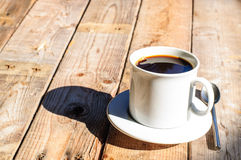 White coffee cup on wooden background Royalty Free Stock Images