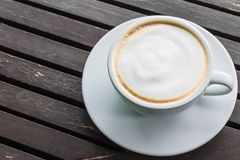 White coffee cup on wooden table.  Stock Photography