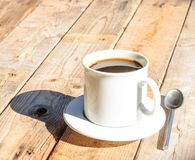 White coffee cup on wooden table background Stock Photography