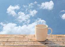 White Coffee cup on wooden table at morning sunlight Royalty Free Stock Photo