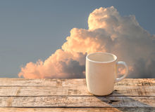 White coffee cup on wooden table at morning sunlight Royalty Free Stock Images