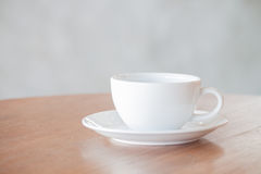 White coffee cup on wooden table royalty free stock photography