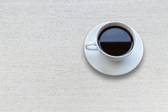 White Coffee Cup On Wooden Table Top View Stock Photo