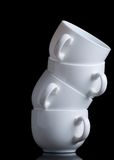 White coffee cups on black Stock Images