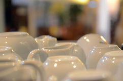 White coffee dishes. Drying white coffee and tea dishes in restaurant Stock Images
