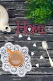 White coffee in the garden in the sunny day. White coffee with sugar in the garden in the sunny day Royalty Free Stock Image