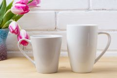 White coffee latte and cappuccino mug mockup with magenta tulip Stock Photos