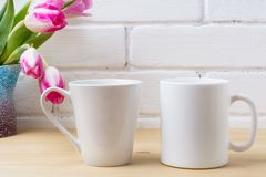 White coffee and latte mug mockup with magenta tulip stock photos