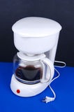A white coffee maker. Stock Photos