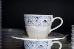 White coffee mug with a beautiful pattern. Royalty Free Stock Photo