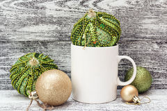 White coffee mug with Christmas decorations. Space for text or d Royalty Free Stock Photos