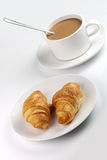 White coffee mug and croissants Royalty Free Stock Photo
