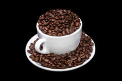 White coffee mug full of coffe beans. Royalty Free Stock Images