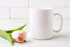 White coffee mug mockup with  pink tulip Stock Photo
