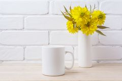 White coffee mug mockup with Golden Ball flower Royalty Free Stock Photography