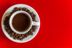 White coffee mug. On a red background. top view. copy space Royalty Free Stock Photography