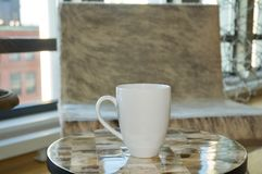White Coffee Mug Sitting in a Stylish Apartment stock image