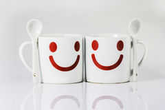 White coffee mug. Two coffee cups smiling mood Stock Images