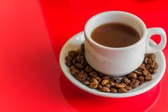 White coffee mug. On a red background.  copy space Stock Images