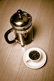 White coffee mug white plate w beans french press Stock Photo