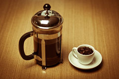 White coffee mug on white plate w/ french press Stock Images