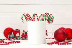 Free White Coffee Mug With Candy Canes And Christmas Decorations On W Stock Photography - 103712402