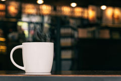 White Coffee Mug On Wooden Table In Cafe With Copyspace Stock Photography
