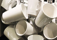 White coffee mugs for cafe service. White coffee mugs hang at cafe ready for service Stock Photos