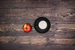 White coffee and red apple.  royalty free stock photo