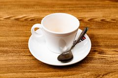 Cup of coffee on wooden table stock image