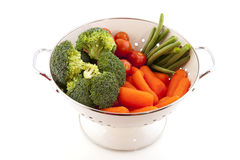 White colander with vegetables Royalty Free Stock Photos