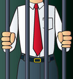 White Collar Criminal. A corrupt white collar criminal behind bars Stock Photo