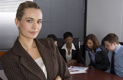 White collar environment. Multi-racial business team sitting around an office boardroom Stock Photography