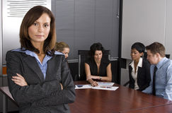 White collar environment. Multi-racial business team sitting around an office boardroom Stock Photo