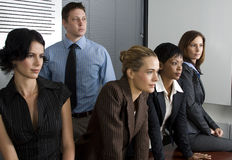 White collar environment. Multi-racial business team sitting around an office boardroom Stock Photos
