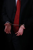 White collar on handcuffs. Arrested business man showing his handcuffed hands Royalty Free Stock Images