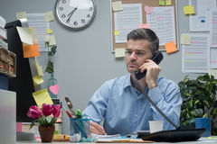 White collar on the phone Stock Image