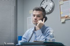 White collar on the phone Royalty Free Stock Photos