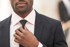 White Collar Worker Adjusting His Necktie Stock Photos
