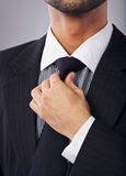 White Collar Worker Adjusting His Necktie Stock Images