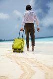 White-collar worker and beach vacation Stock Photo