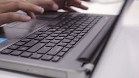 White collar worker hand is typing the computer or laptop at workplace stock video footage