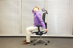 White collar worker male relaxing neck - demonstration Royalty Free Stock Images