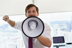 White Collar Worker With Megaphone Fighting For Labor Rights Royalty Free Stock Image
