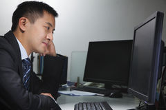White-collar worker sitting in front of computer in office Stock Photo