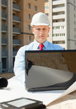 White-collar worker works on the building site Royalty Free Stock Photography