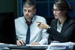 White collar workers working overtime Stock Photos