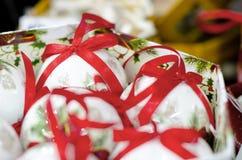 White collection of Christmas ribon Balls. White collection of Christmas Balls with red ribons stock photography