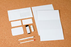 White collection of stationery on corkboard background. Royalty Free Stock Photo