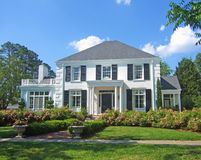 White colonial home. A white luxury colonial style home Stock Photography